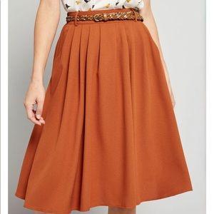 Orange skirt with belt